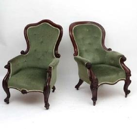 A matched pair of Victorian library / armchairs with