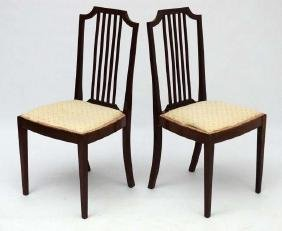 A pair of c.1900 mahogany overstuffed boudoir chairs