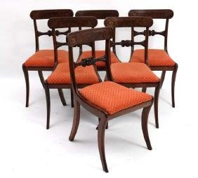 A set of 6 Regency mahogany sabre legged dining chairs