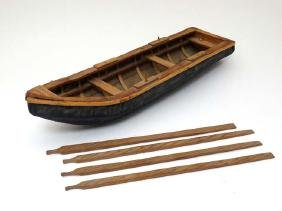Toy: A small hand made wooden toy boat with 4 oars, the