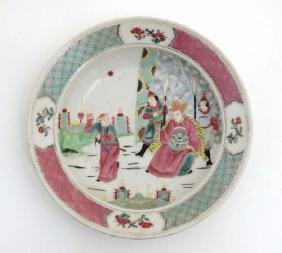 A Chinese famille rose bowl decorated in polychrome