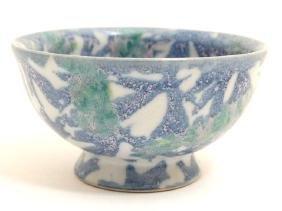 An Oriental style studio pottery bowl, having branch