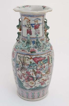 A large Chinese Canton famille rose vase of baluster