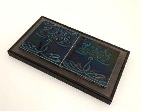 A pair of framed Art Nouveau majolica style tiles in
