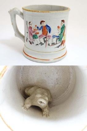 A Victorian Staffordshire tankard / frog mug, the