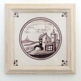 A framed 19thC manganese Dutch Delft tile , decorated