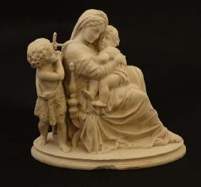 A Parian figure of Madonna and Child with child figure