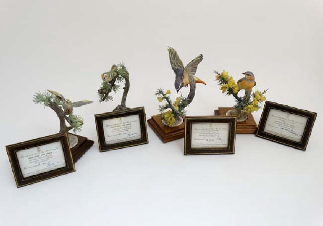 Two pairs of Royal Worcester limited edition birds on