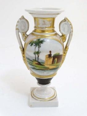 A Paris Porcelain style twin handled pedestal vase on a