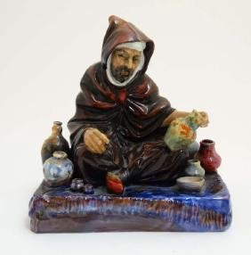 A 20thC Royal Doulton '' The Potter '' figurine, formed