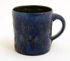 A 1911 Brannam Pottery Coronation mug in cobalt blue ,