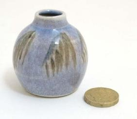 A small studio pottery vase , decorated in shades of