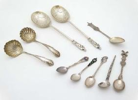 Assorted spoons to include a silver sifter ladle and