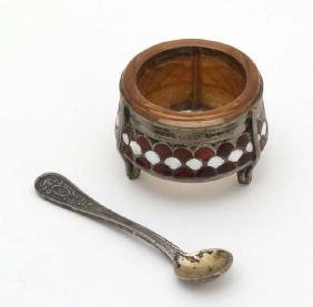A gilt and enamel decorated base metal salt with glass