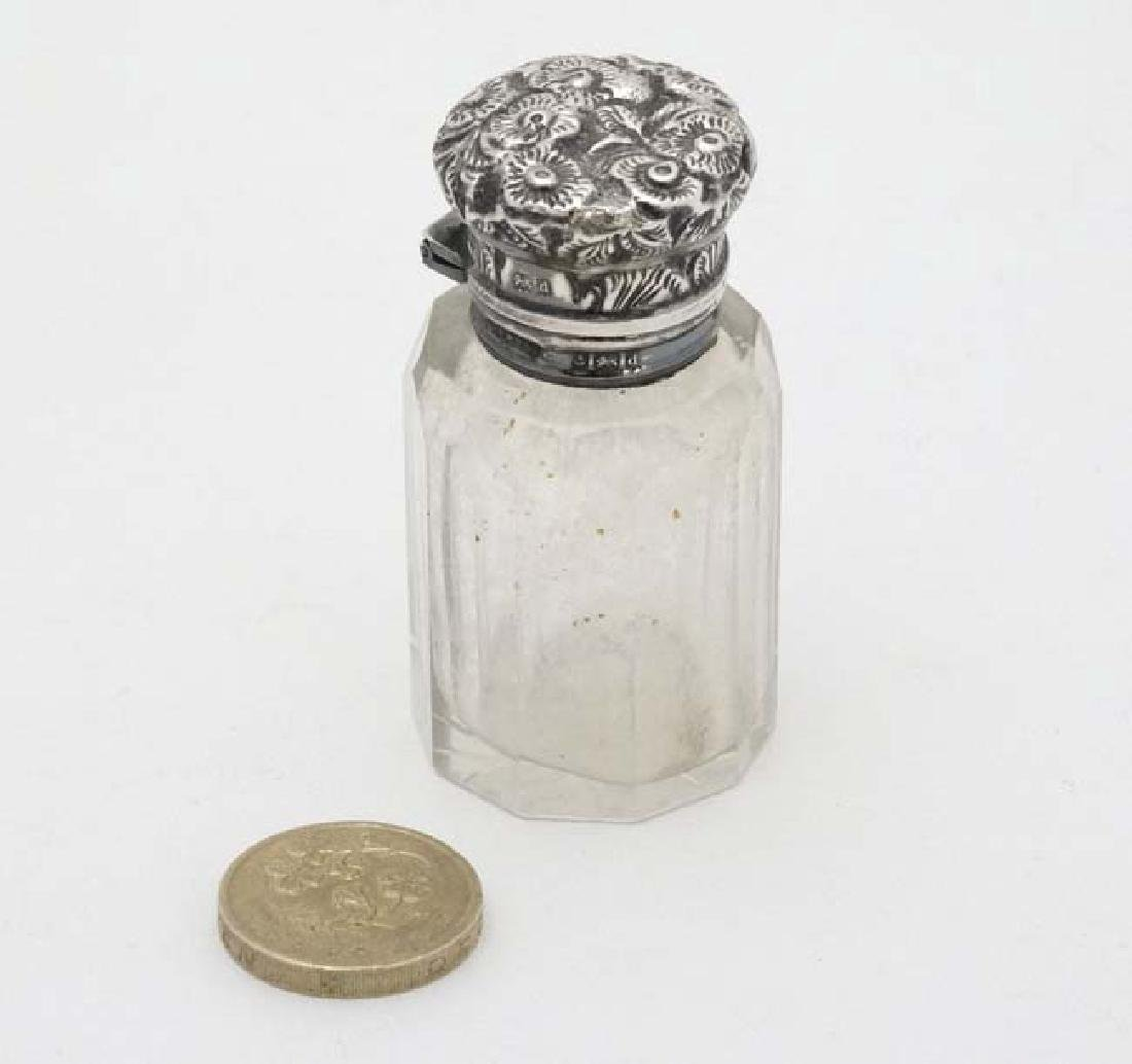 A glass pot with silver top hallmarked Birmingham 1903 - 3