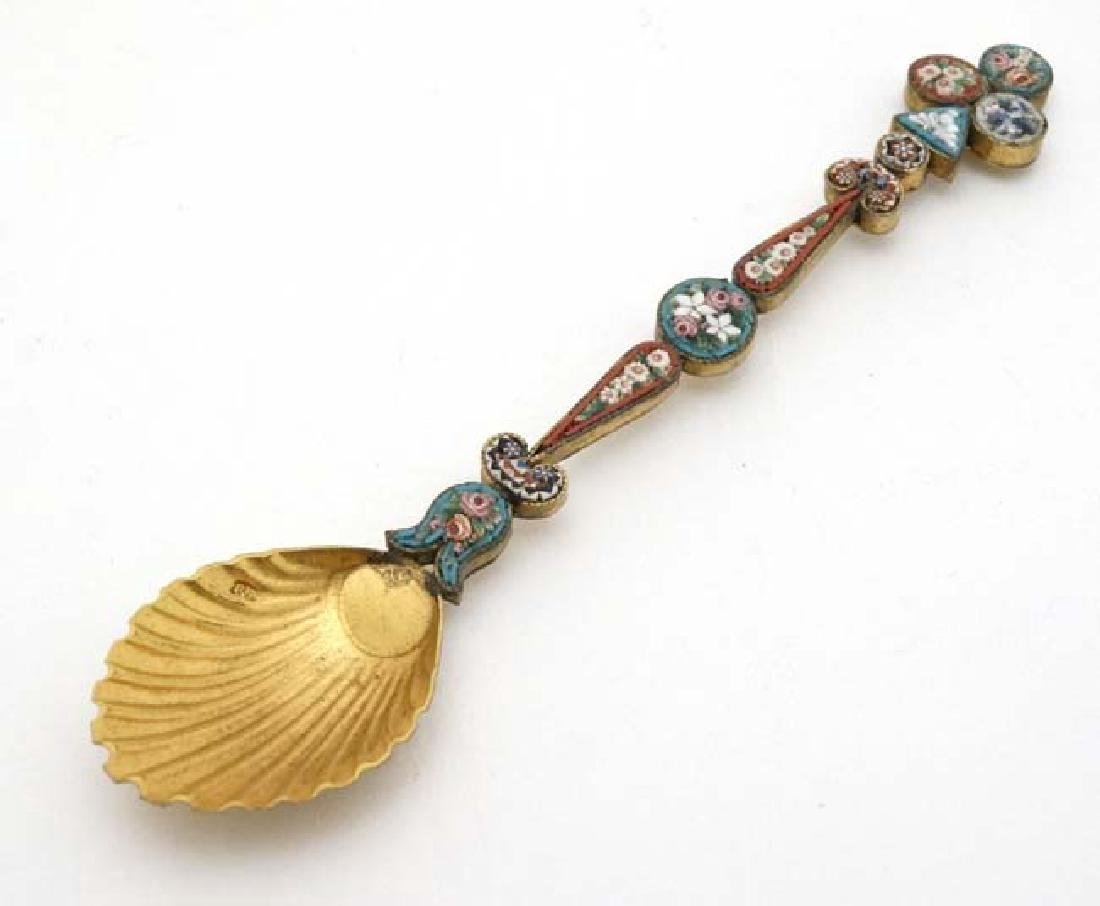 A white metal gilt decorated spoon with micro mosaic
