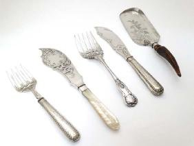 Assorted silver plated fish servers together with a