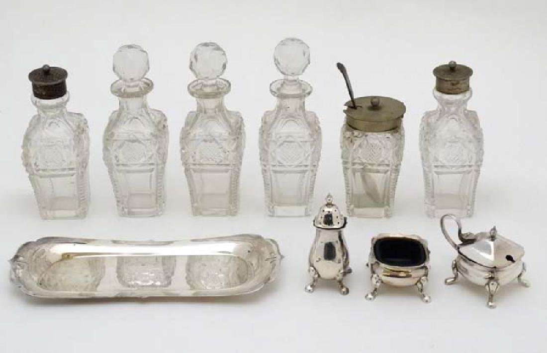 Assorted glass cruet bottles together with a silver