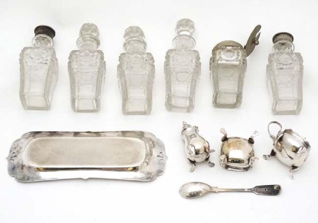 Assorted glass cruet bottles together with a silver - 5