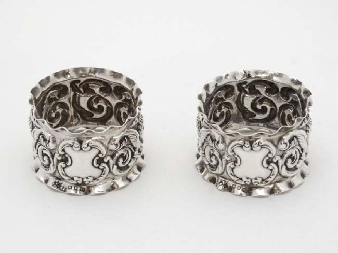 A pair of Victorian silver napkin rings with embossed