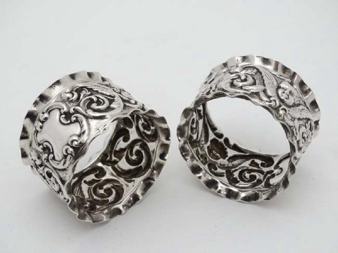 A pair of Victorian silver napkin rings with embossed - 2