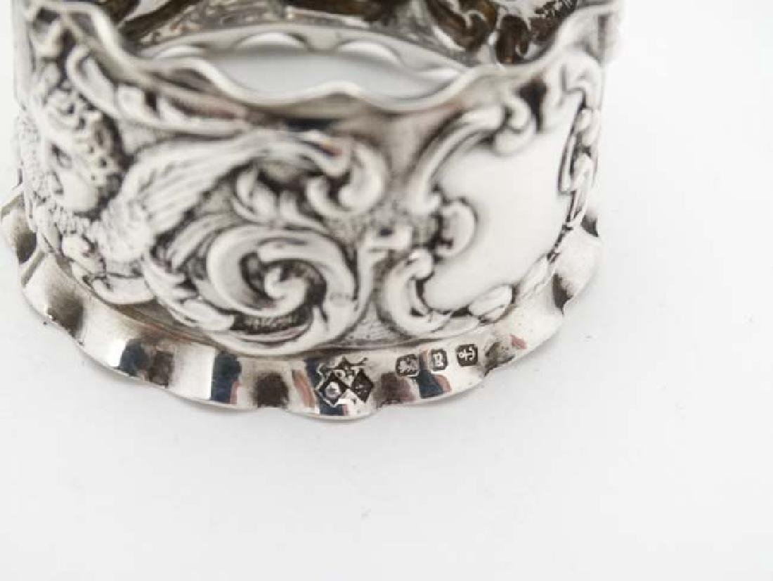 A pair of Victorian silver napkin rings with embossed - 4