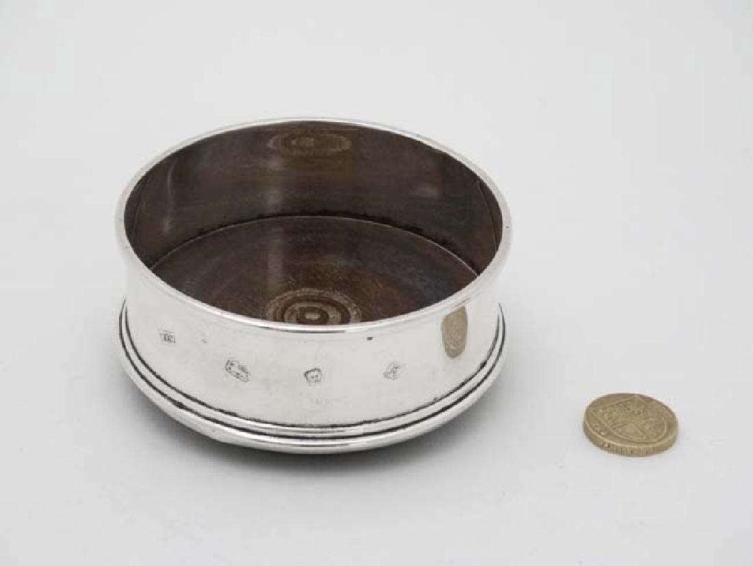 A silver coaster with turned wooden base London 1984 - 3