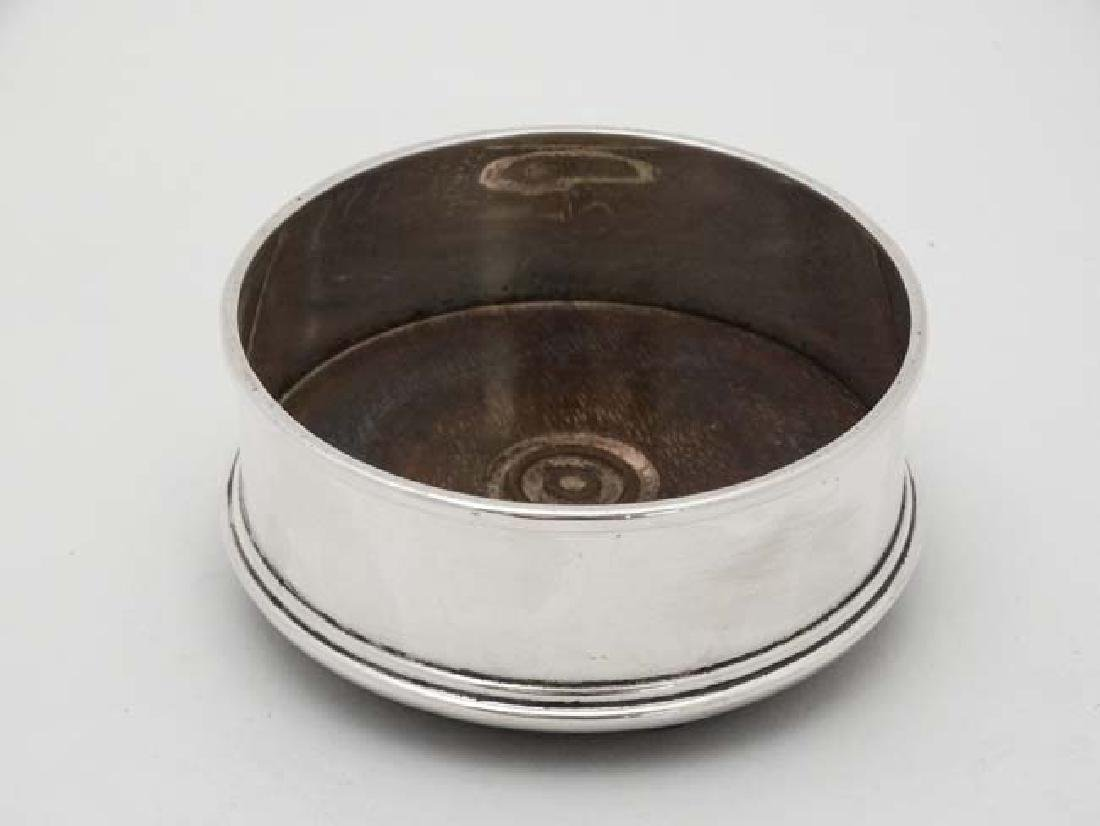 A silver coaster with turned wooden base London 1984 - 5