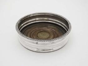 A Sheffield plate bottle coaster with gadrooned rim and