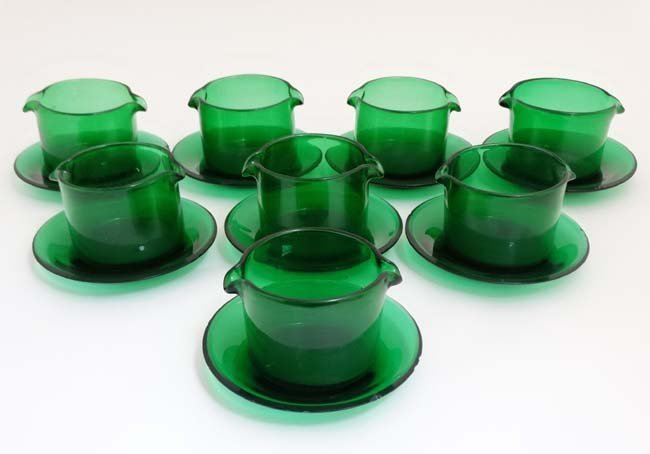 A set of 8 19thC green glass rinsers with double spouts