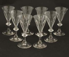 A 8 pedestal glasses with conical facet cut glass bowls