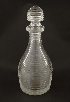 A 19thC cut glass / crystal decanter with cut ring