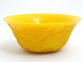 A Chinese yellow Peking glass bowl with dragon