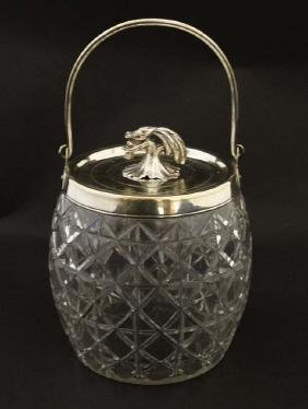 A cut glass biscuit barrel with silver plated rim,