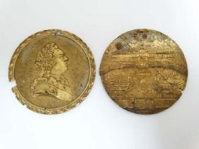 A pair of 19thC gilded medallions mounted on