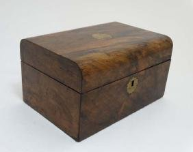 A 19thC walnut semi-domed ladies workbox with lift out