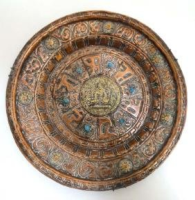 A 19thC Indian copper repoussee wall charger with brass