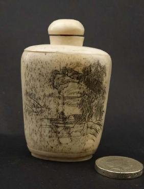 An Oriental bone snuff bottle with script and image. 2