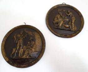 Two 19thC painted cast iron plaques with classical