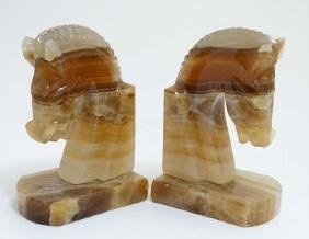 A pair of onyx horse head bookends 5'' high