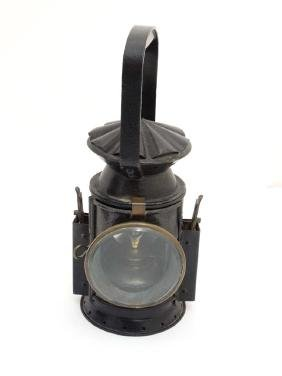 Early potable oil signal lamp torch having clear red