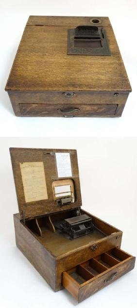 An early 20thC Dutch NCR wooden shop till with drawer