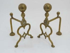 A pair of c.1900 cast brass firedogs with spherical
