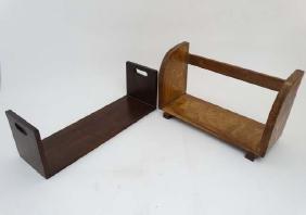 An Art Deco oak book trough together with a mahogany