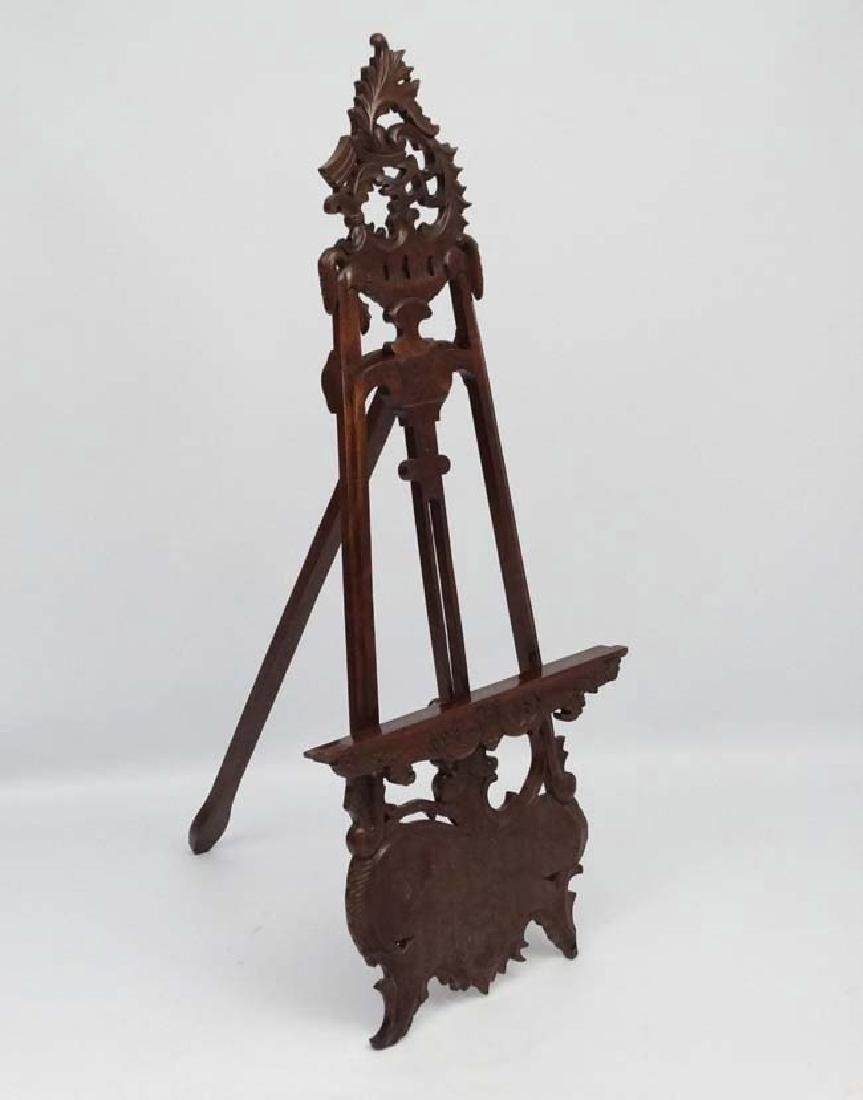 A mid - late 20thC carved wooden adjustable height