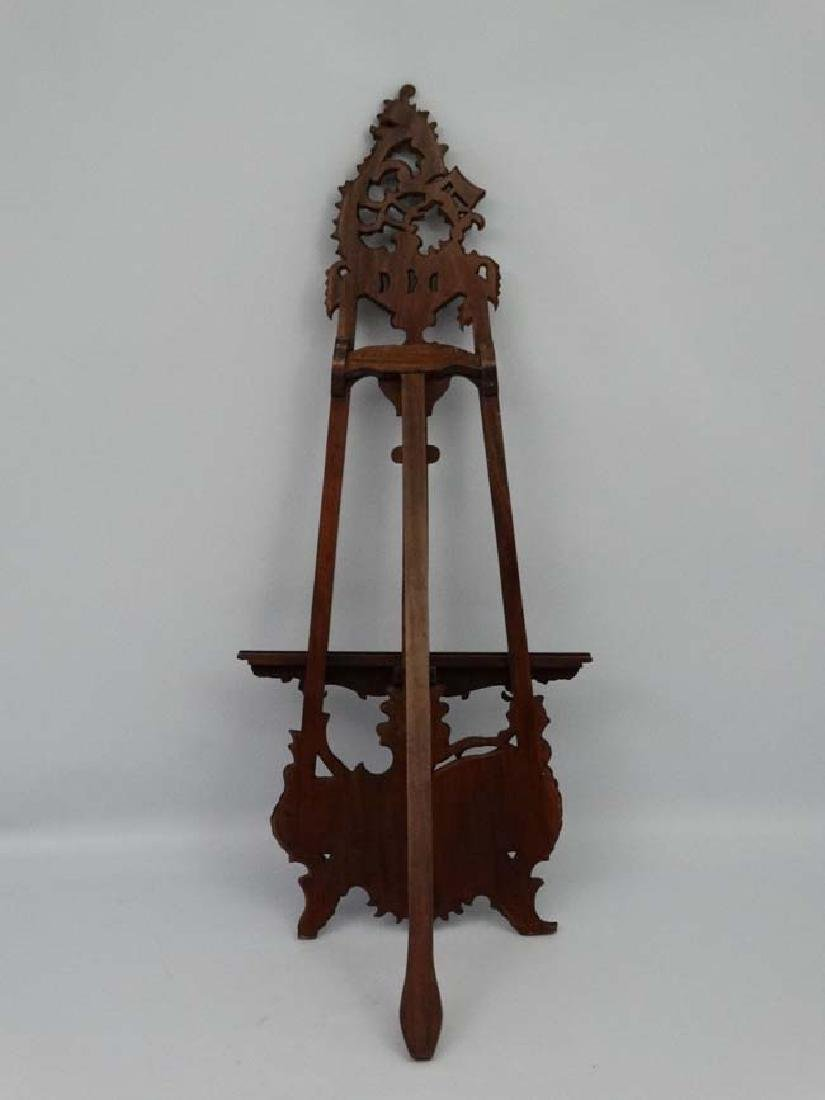 A mid - late 20thC carved wooden adjustable height - 2