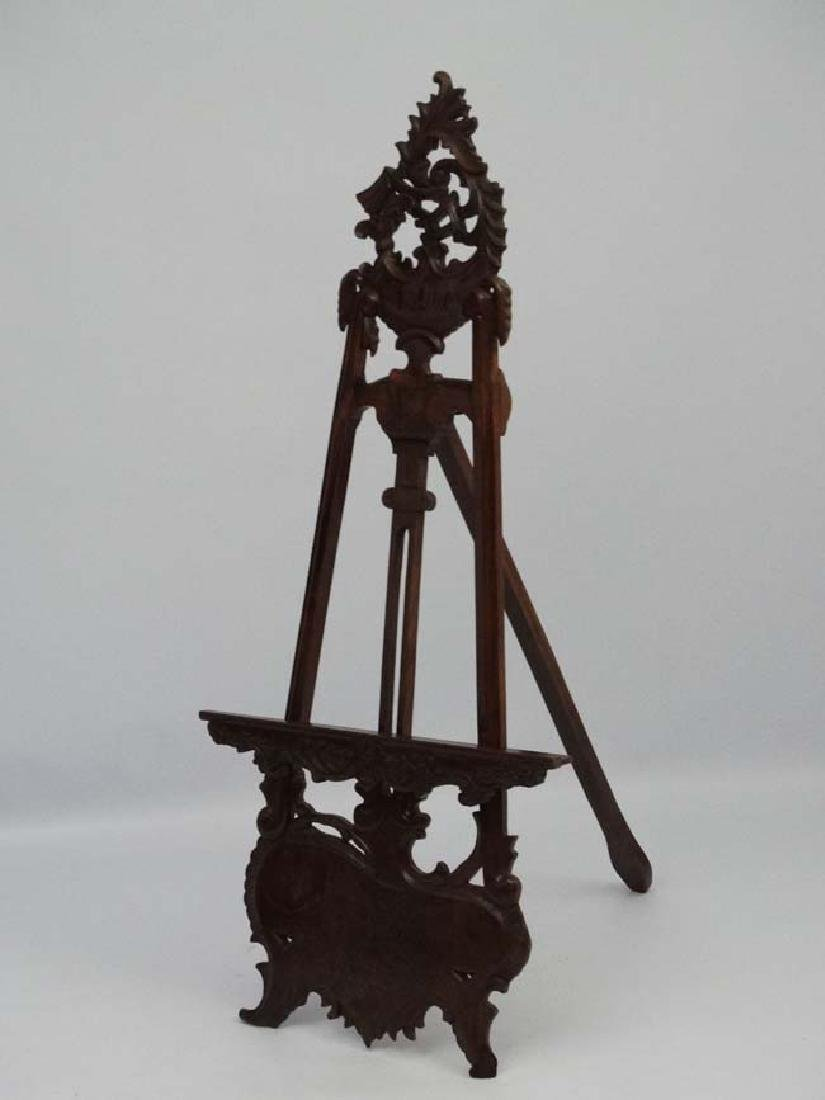 A mid - late 20thC carved wooden adjustable height - 5
