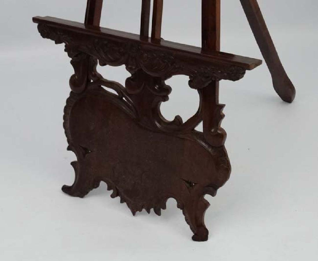 A mid - late 20thC carved wooden adjustable height - 6