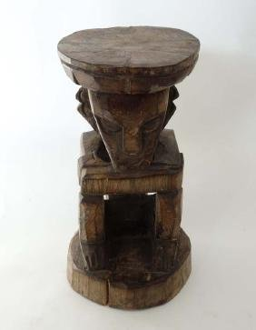An ethnographic African native tribal carved wooden