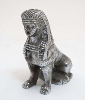 Car mascot : A chromed Sphinx , formerly from an